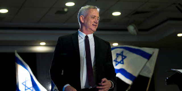 In this Wednesday, March 27, 2019 file photo, retired Israeli general Benny Gantz, one of the leaders of the Blue and White party, prepares to deliver a speech during election campaigning for elections to be held April 9, in Ramat Gan, Israel. Down in the polls, Israeli Prime Minister Benjamin Netanyahu's Likud Party has released a new campaign trying to paint Gantz, his main rival, as mentally unstable. The video ads are the latest move in a campaign that has been heavy on personal insults and short on substance. (AP Photo/Oded Balilty, File)
