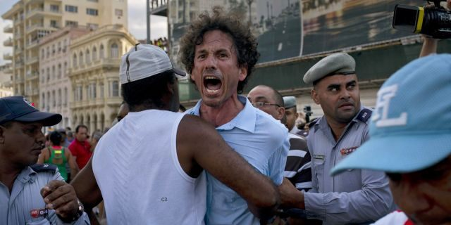 Cuban police detain a gay rights activist taking part in an unauthorized march in Havana, Cuba, Saturday, May 11, 2019. The march was organized largely using Cuba's new mobile internet, with gay-rights activists and groups of friends calling for a march over Facebook and WhatsApp after the government-run gay rights organization canceled a Saturday march.