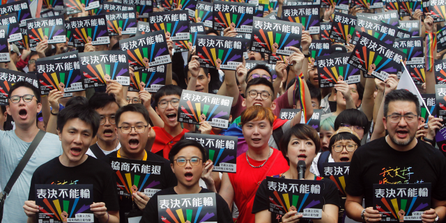 Same-sex marriage supporters gather outside the Legislative Yuan in Taipei, Taiwan, on Friday. (Associated Press)