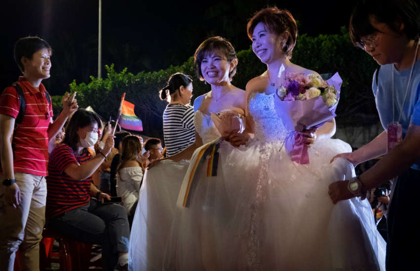 Taiwan's hosts its first ever mass same-sex wedding banquet