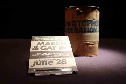 A donation can and stickered flyer from the first Gay Pride Event in New York City.