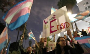 Nicoletta Thibeault, right, attends a rally in Los Angeles protesting transgender discrimination.