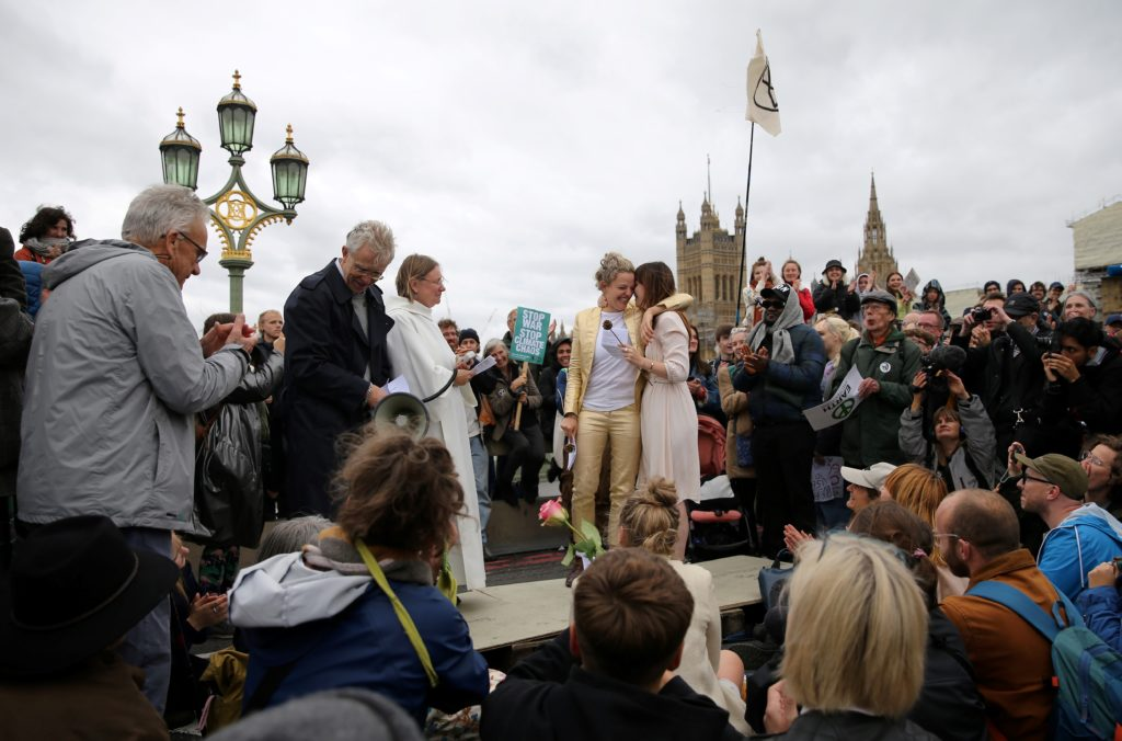 The pair were surrounded by activists from the climate change group Extinction Rebellion