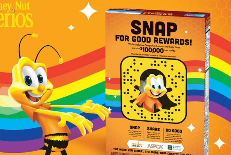 The Honey Nut Cheerios bee motions towards a box of cereal with a snapchat code on the back. A rainbow waves in the background.