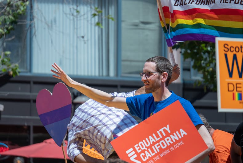 SAN FRANCISCO, CA JUNE 24, 2018: California State Senator Scott Weiner waves to the crowd at the 2018 San Francisco Pride Parade