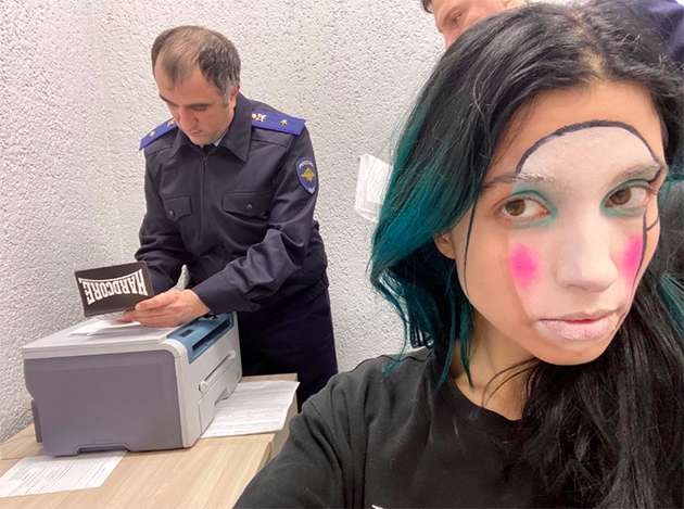 Police processing Pussy Riot members.