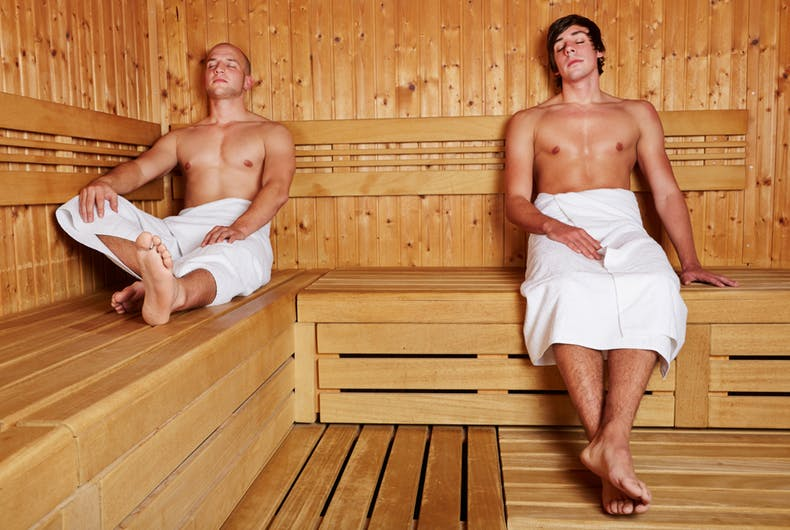 Two men in a sauna.
