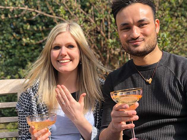 Lewis Oakley and his fiancée toast their engagement.