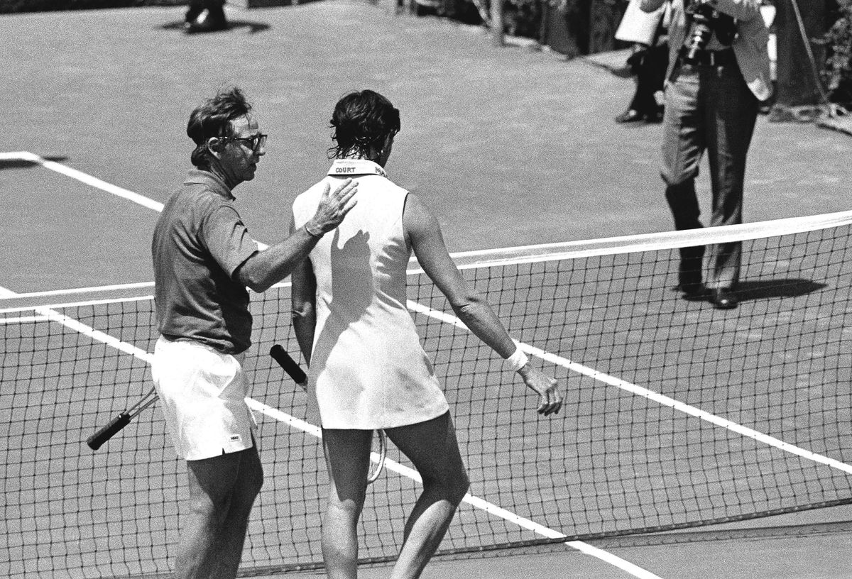 """Australia's Margaret Court, 30, rated the world's No. 1 woman tennis player, gets a pat on the back from Bobby Riggs, 55, after he easily defeated her in their celebrated match game at Ramona, Calif., May 13, 1973. Riggs, former world's men's champion, won with an assortment of his """"junk"""" shots."""
