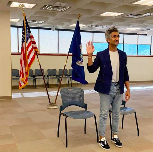 Tan France taking the oath in his US citizenship ceremony.