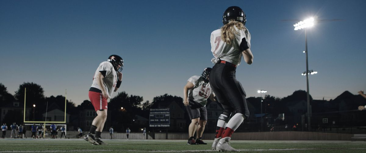 """Quarterback Allison Cahill in a scene from """"Born to Play."""""""