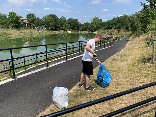 One of the campaigners picking up trash.