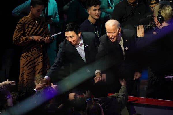 Andrew Yang and Joseph R. Biden Jr. shaking hands after the Democratic debate in Manchester, N.H., in February.