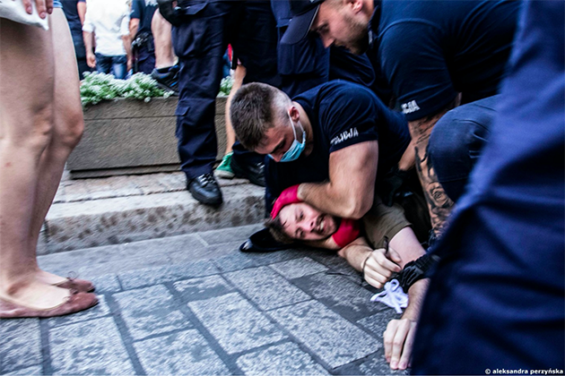 Police hold man on the ground.