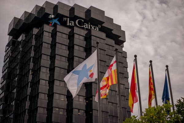 CaixaBank, based in Barcelona, agreed to merge with Bankia, the institution that was at the heart of Spain's financial crisis and 2012 banking bailout.