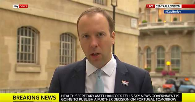 Matt Hancock wears the NHS rainbow badge as he defends Tony Abbott's appointment.