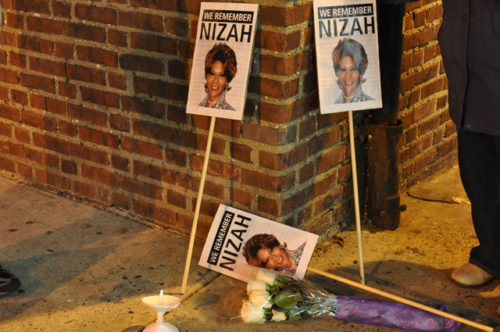 Justice for Nizah Morris candles and signs