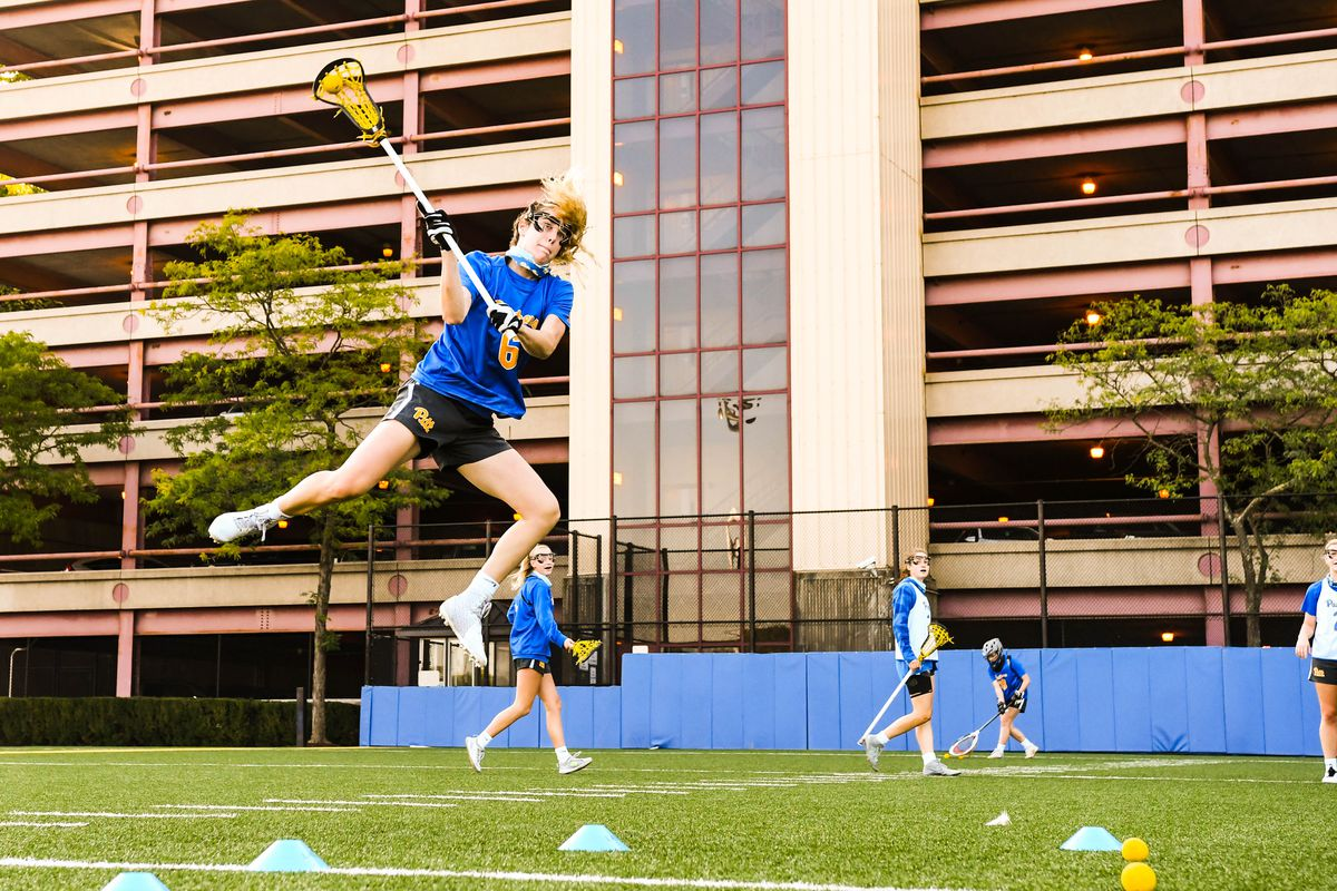 Therese Pitman goes high during lacrosse practice at Pitt.