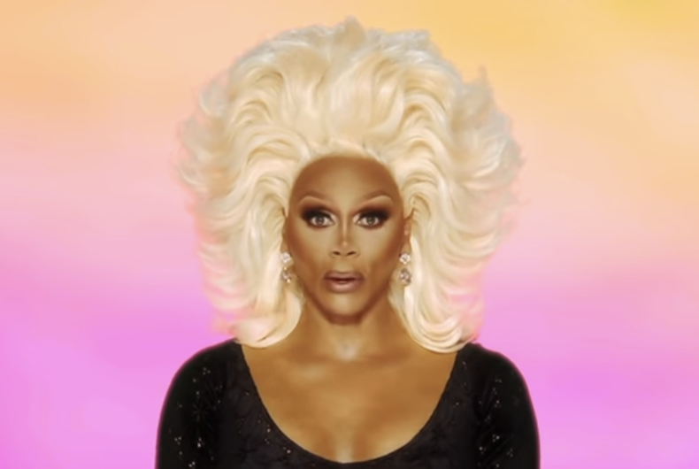RuPaul wearing a blonde wig and black shirt in the Season 13 premiere of