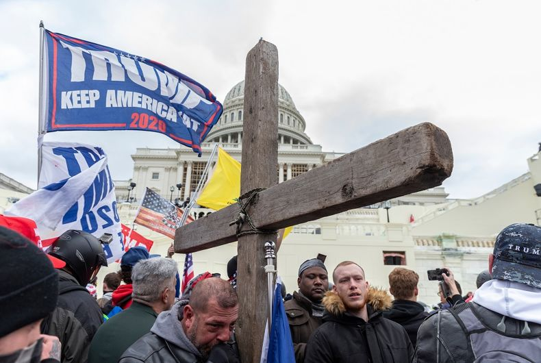 Washington, DC - January 6, 2021: Pro-Trump protester with Christian Cross seen during rally around at Capitol building