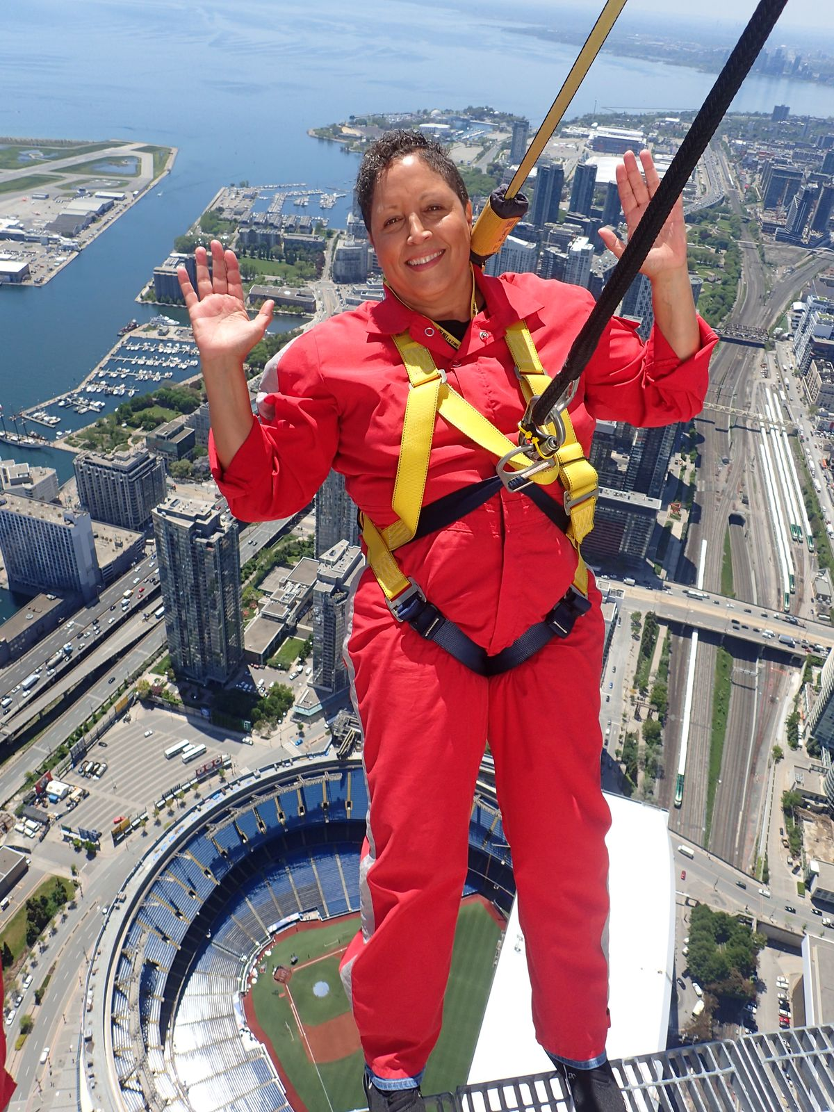 Nona Lee poses for a picture high above Toronto's baseball stadium.