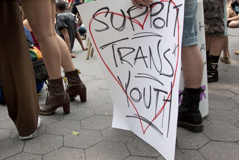 : A supporter holds a sign that says