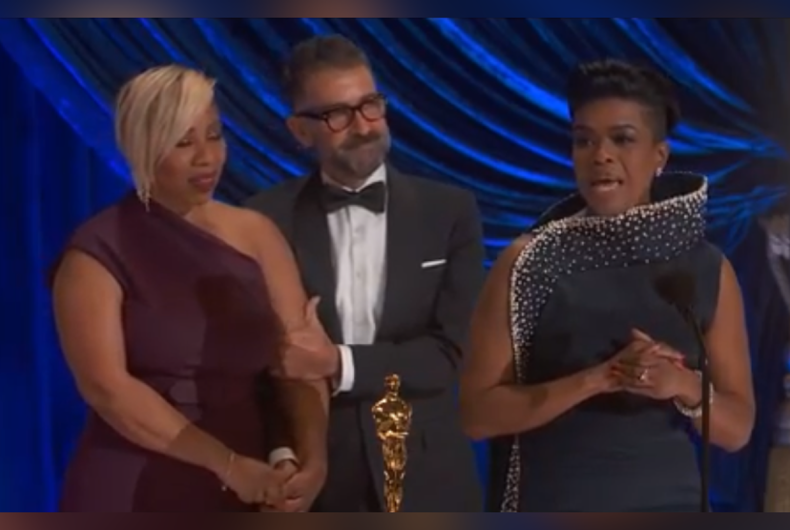 Mia Neal (right) accepting the Academy Award for Hair and Makeup alongside Jamika Wilson and Sergio Lopez-Rivera