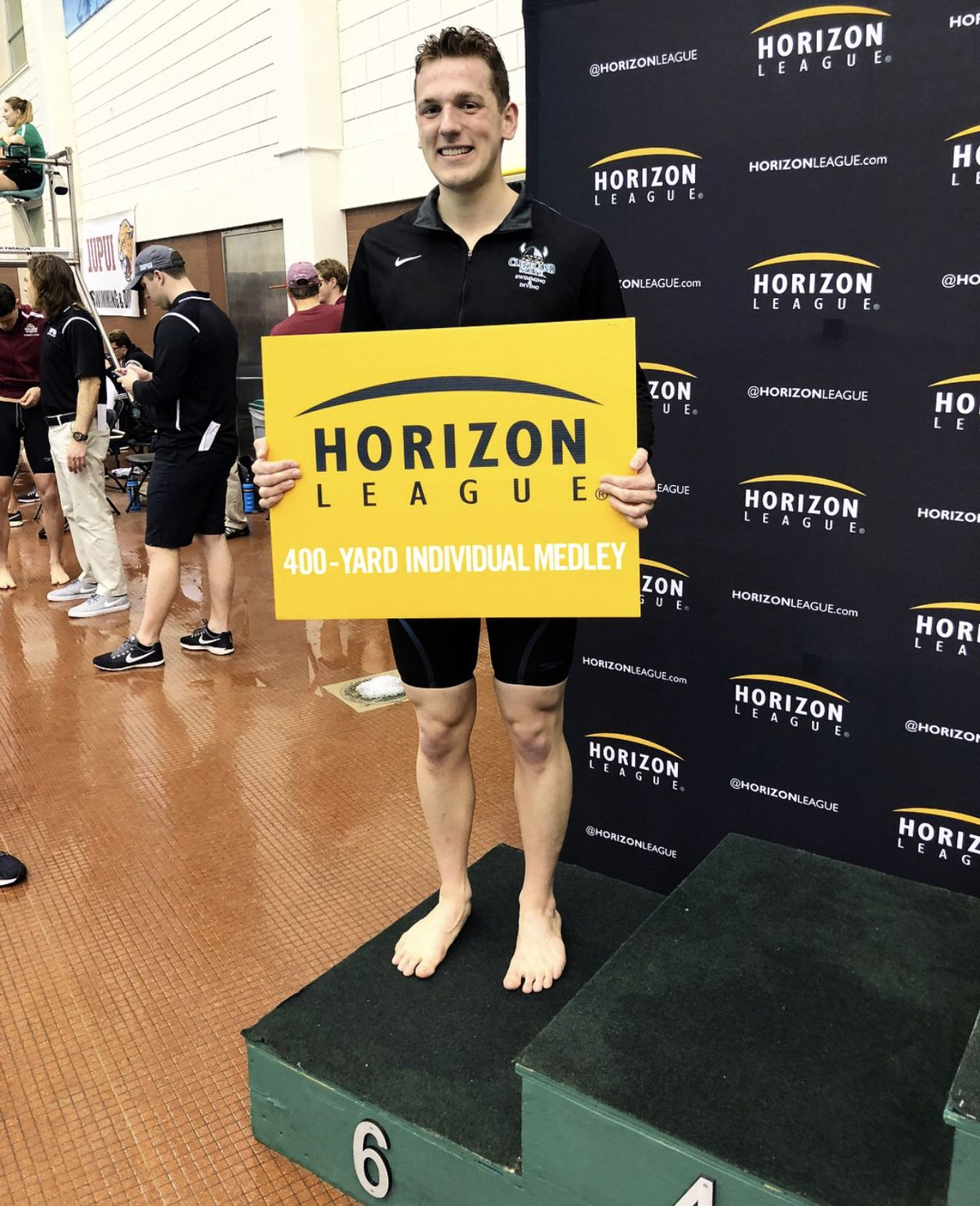 MacJilton Lewis on the podium at the Horizon League championships in his junior year in the 400 IM.