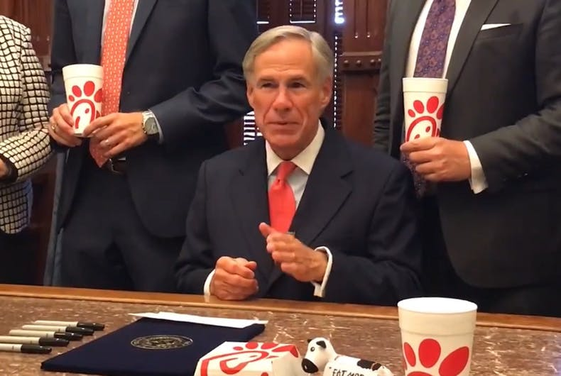 Texas Governor Greg Abbott surrounded himself with fast food sandwiches to sign the